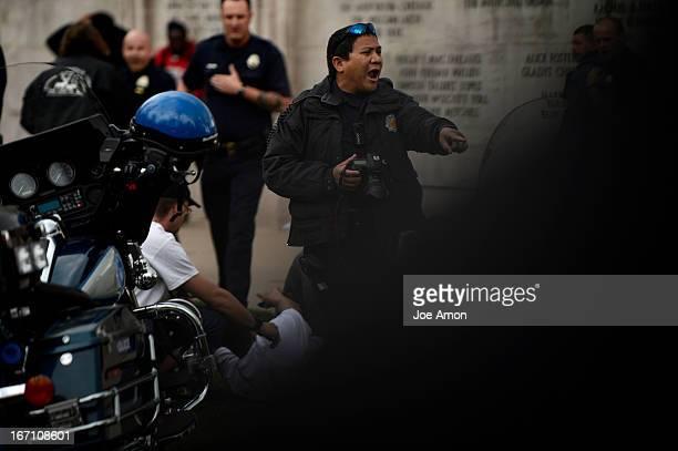 April 20 Denver Paramedics Denver Police officers and good samaritans at the scene attend to a shooting victim at Civic Center Park in Denver...
