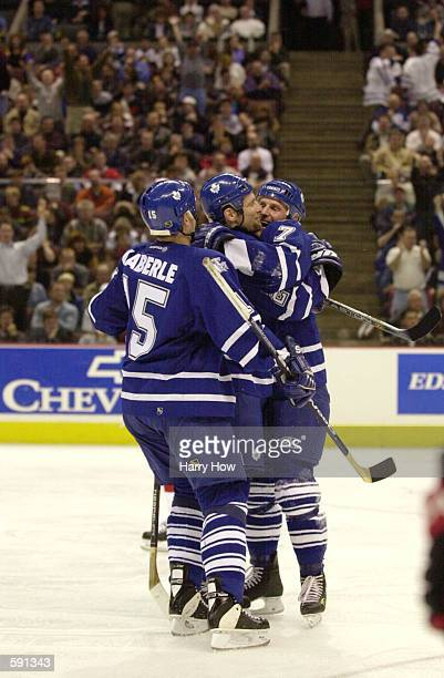 Gary Roberts celebrates his winning goal with teammates Bryan McCabe and Tomas Kaberle of the Toronto Maple Leafs during game 2 of the eastern...