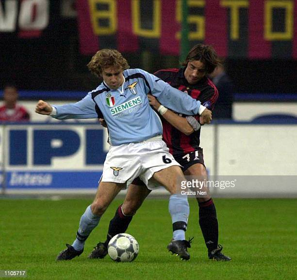 Karel Poborsky of Lazio and Francesco Coco of AC Milan in action during the Serie A 24th Round League match between AC Milan and Lazio played at the...