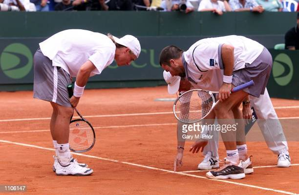 April 2001; Lleyton Hewitt and Patrick Rafter assess a merk with the umpire during their straight sets doubles victory over Gustavo Kuerten and Jaime...