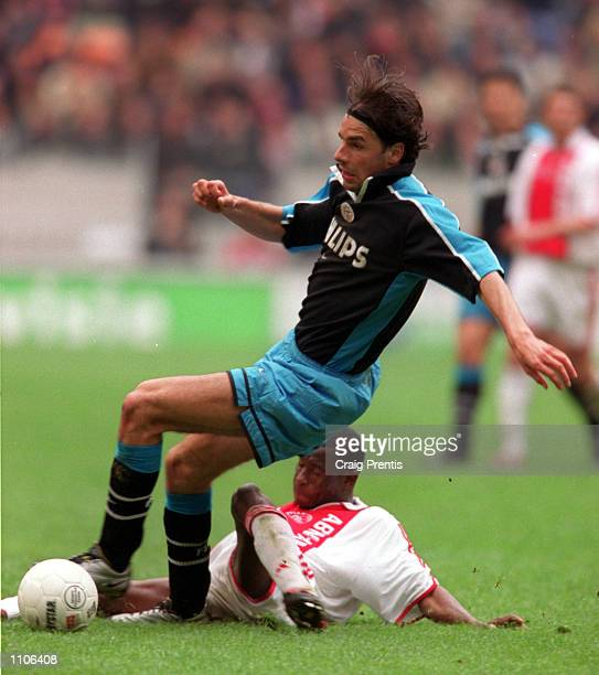 8 April 2001 Ruud Van Nistelrooy of PSV Eindhoven is tackled by Abubakari Yakubu of Ajax during the league match between Ajax and PSV at the...