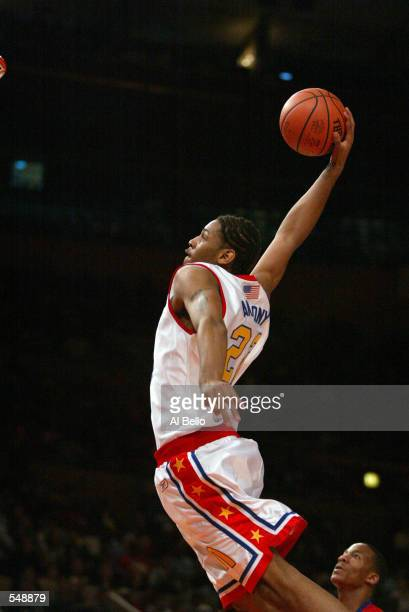Carmelo Anthony of the East team dunks over the defense of the West team during the McDonalds boys High School All America Game at Madison Square...