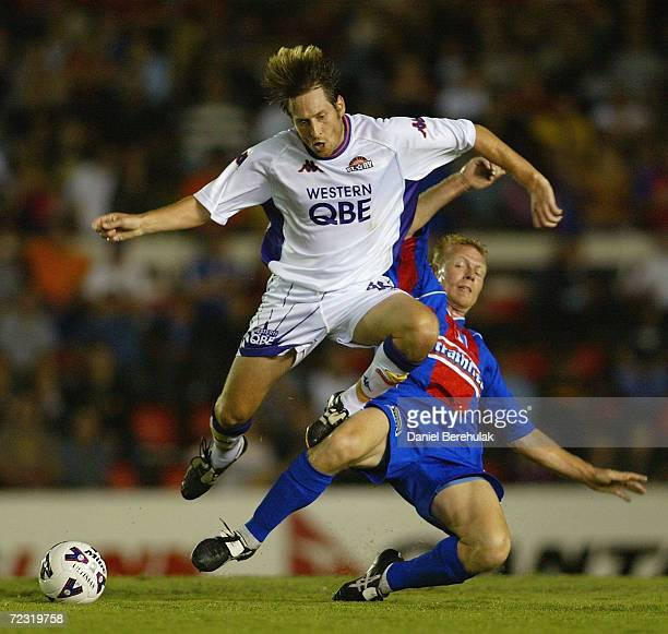 Matthew Bingley of Newcastle tackles Bobby Despotovski of the Glory during the NSL major semifinal between Newcastle United and the Perth Glory...