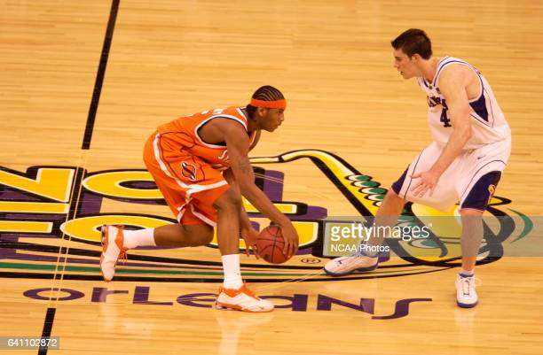 Syracuse forward Carmelo Anthony dribbles the ball upcourt against Kansas forward Nick Collison during the Men's Division I Final Four Championships...