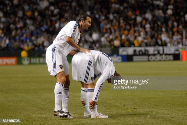 Los Angeles Galaxy Chris Klein comes to comfort Los Angeles Galaxy David Beckham after straining his legs during a Major League Soccer game between...