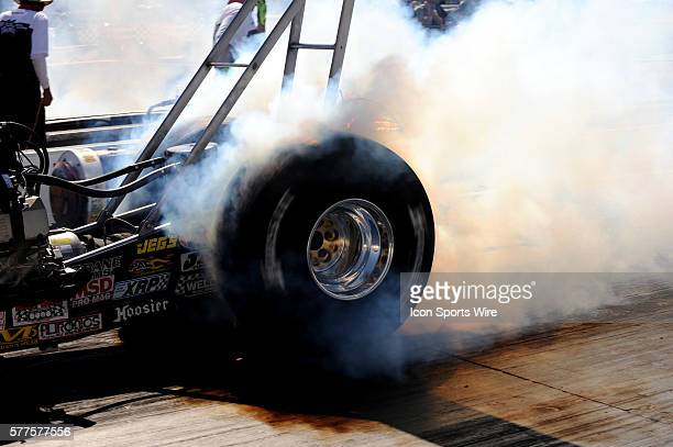 An alcohol dragster does a burnout during the NHRA SummitRacingcom Nationals at The Strip of the Las Vegas Motor Speedway in Las Vegas NV