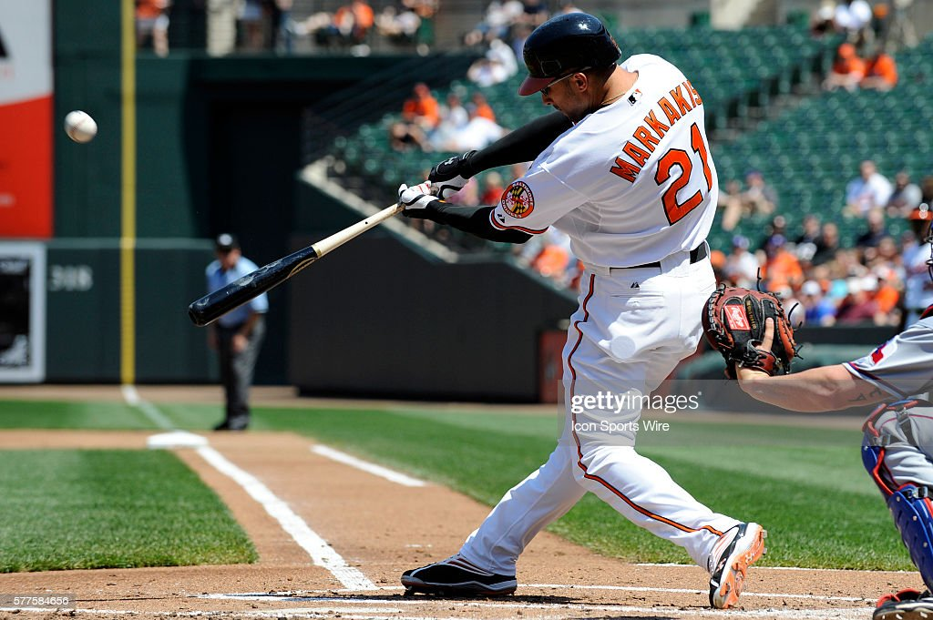 Baltimore Orioles right fielder Nick Markakis (21) hits a sacrifice fly to score second baseman Brian Roberts in the 1st inning against the Texas Rangers at Camden Yards in Baltimore, MD. The Orioles came from behind to defeat the Rangers 8-5.