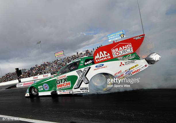 John Force Ford Mustang NHRA Funny Car does a burnout during the NHRA SummitRacingcom Nationals at The Strip of the Las Vegas Motor Speedway in Las...