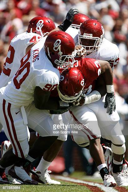 Oklahoma running back Jermie Calhoun is tackled by defensive end David King and defensive lineman Casey Walker during the University of Oklahoma...