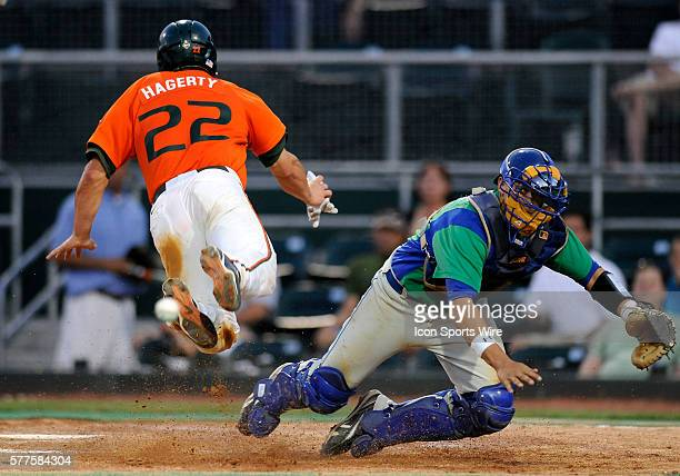 University of Miami catcher/infielder Jason Hagerty dives home as Florida Gulf Coast University catcher Robert Greene looks for the ball at Alex...