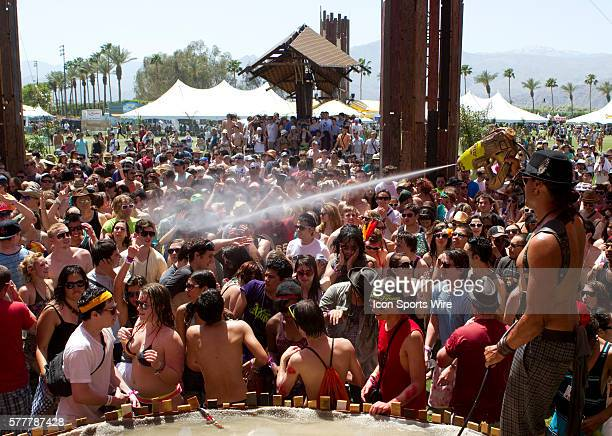 Attendees cool off at the dolab during the first day of the Coachella Valley Music and Arts Festival held at the Empire Polo Grounds in Indio CA