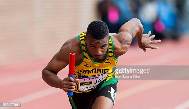 Allodin Fothergill explodes off the starting blocks for the start of the USA vs the World Men 4x400 during the Penn Relays at Franklin Field in...
