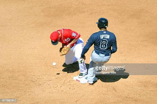 Atlanta Braves left fielder Justin Upton is save at second base on an error by Washington Nationals second baseman Danny Espinosa at Nationals Park...