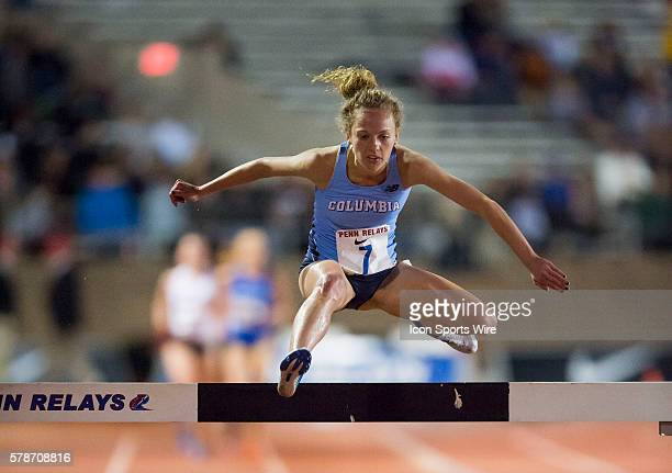 Chelsea Carrick representing Columbia University leaps a hurdle in the College Women's 3000m Steeplechase Championship during the Penn Relays at...