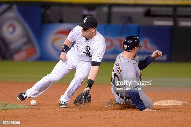 Detroit Tigers catcher Bryan Holaday safely steals second base ahead of the tag from Chicago White Sox second baseman Gordon Beckham in the eighth...