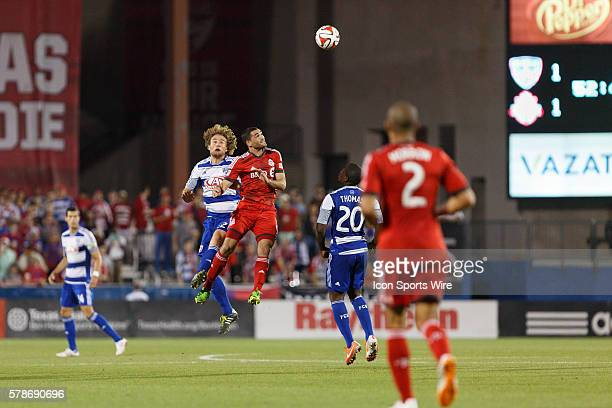 Dallas defender Stephen Keel and Toronto FC forward Gilberto go for a header during the MLS soccer match between Toronto FC and FC Dallas at Toyota...