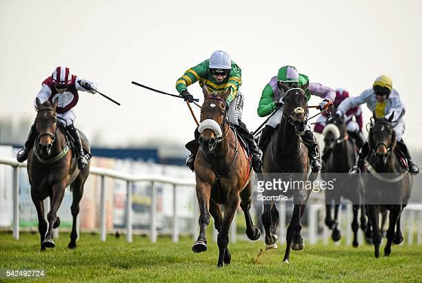 21 April 2014 Free Expression centre with Nina Carberry up races clear from Rock On Fruity left with Niall Kelly up and Clondaw Capable right with...