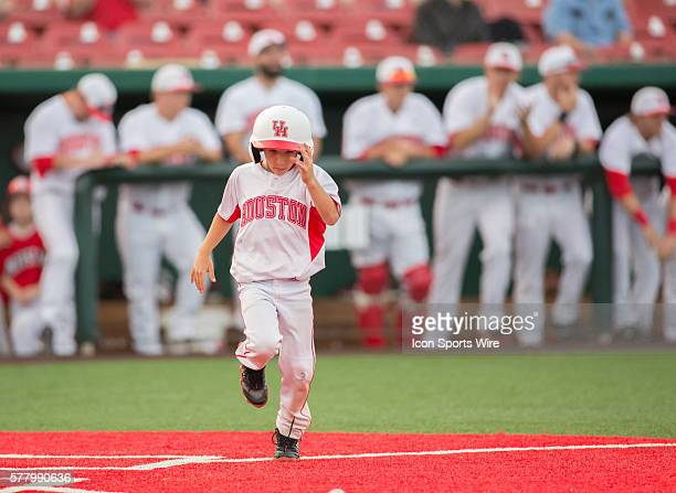 Houston Cougars bat boy runs out to the field for pick up duty during the NCAA baseball game Louisville at University of Houston at Cougar Field in...