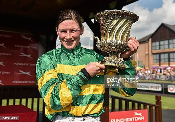 29 April 2014 Jockey Nina Carberry celebrates with the Ladies Cup after she rode Be Positive to win the Kildare Hunt Club Fr Sean Breen Memorial...