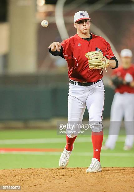 Louisville Cardinals pitcher Kyle Funkhouser throws to first base during the NCAA baseball game, Louisville at University of Houston at Cougar Field...