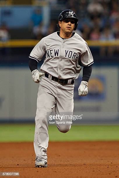 New York Yankees second baseman Brian Roberts heads toward third base as he triples in the 2nd inning of the MLB regular season game between the New...