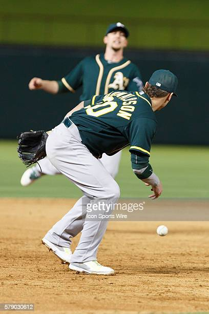 Oakland Athletics shortstop Jed Lowrie juggles a line drive which bounces to third baseman Josh Donaldson during the MLB baseball game between the...
