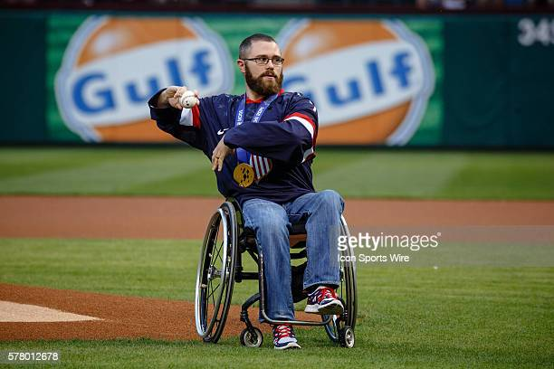 Paraolympic hockey gold medalist Taylor Lipsett throws out the first pitch during the MLB baseball game between the Texas Rangers and Chicago White...