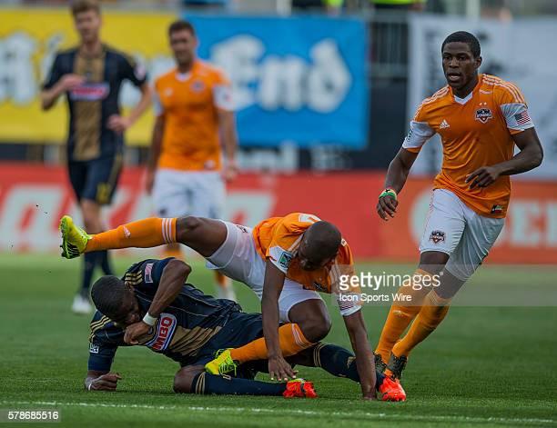 Philadelphia Union midfielder Maurice Edu ducks to avoid Houston Dynamo midfielder Boniek Garcia during the MLS game between Houston Dynamo and the...