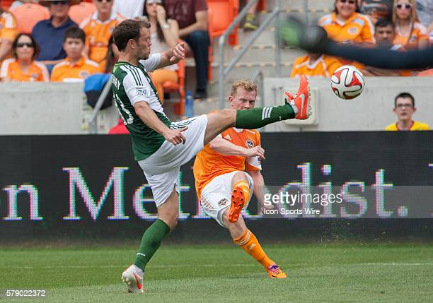 Portland Timbers midfielder Jack Jewsbury and Houston Dynamo midfielder Andrew Driver during the MLS game Portland Timbers vs Houston Dynamo at the...