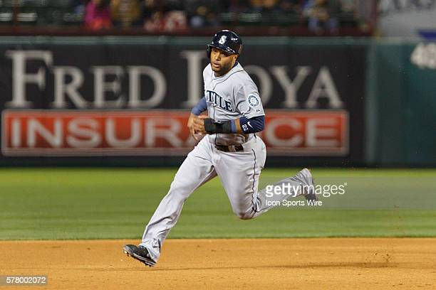 Seattle Mariners Second base Robinson Cano [3913] circles around 2nd base during the MLB baseball game between the Texas Rangers and Seattle Mariners...
