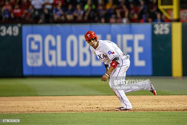 Texas Rangers catcher Robinson Chirinos heads to second base during the MLB baseball game between the Texas Rangers and Oakland Athletics at the...