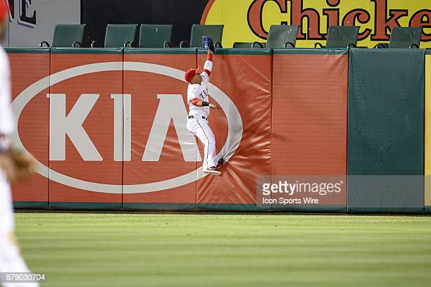 Texas Rangers center fielder Leonys Martin makes a leaping catch and doubles off the runner at first during the MLB baseball game between the Texas...
