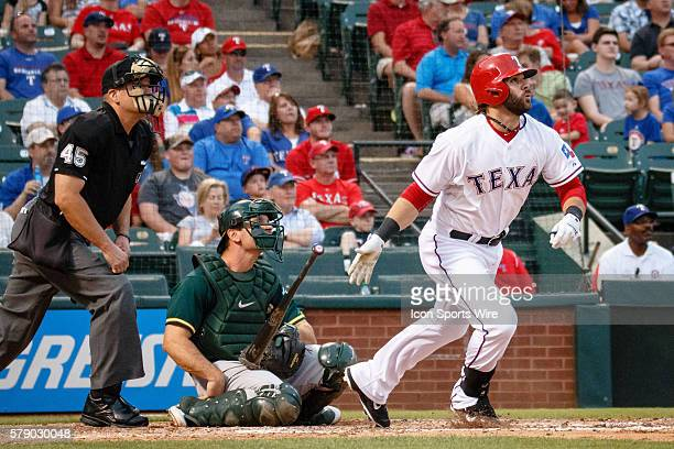 Texas Rangers designator hitter Mitch Moreland hits a long fly out during the MLB baseball game between the Texas Rangers and Oakland Athletics at...