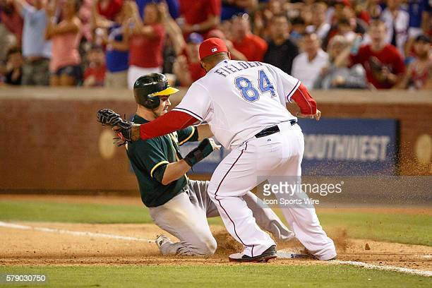 Texas Rangers first baseman Prince Fielder beats Oakland Athletics right fielder Josh Reddick back to the bag for a double play during the MLB...