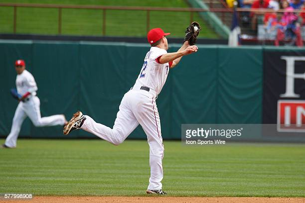 Texas Rangers second baseman Josh Wilson makes a stretching catch to his left during the MLB baseball game between the Texas Rangers and Houston...