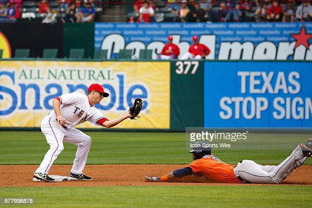 Texas Rangers second baseman Josh Wilson tags out a steal attempt by Houston Astros shortstop Jonathan Villar during the MLB baseball game between...