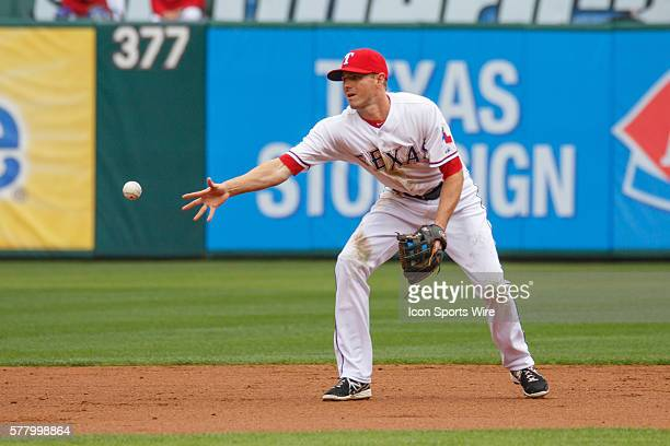 Texas Rangers second baseman Josh Wilson tosses the ball to second to start a double play during the MLB baseball game between the Texas Rangers and...