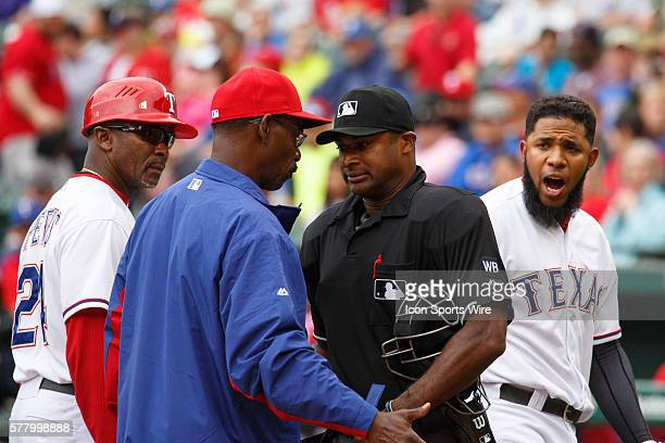 Texas Rangers shortstop Elvis Andrus is thrown out of the game for arguing a strike three call by umpire Alan Porter in 4th inning of the MLB...