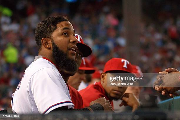 Texas Rangers shortstop Elvis Andrus watches the scoreboard from the Rangers bench during the MLB baseball game between the Texas Rangers and Oakland...