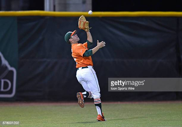 University of Miami outfielder Tyler Palmer catches a fly ball against the University of Pittsburgh at Alex Rodriguez Park at Mark Light Field Coral...
