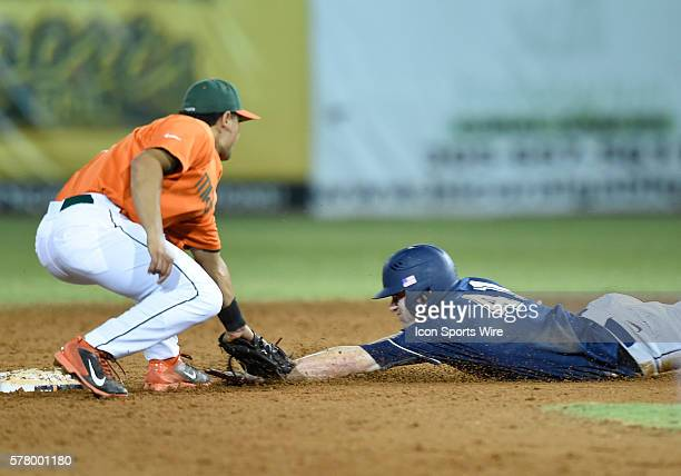 University of Pittsburgh outfielder/right handed pitcher Casey Roche is tagged out by University of Miami infielder Alex Hernandez at Alex Rodriguez...