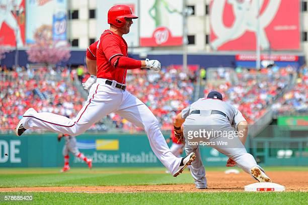 Washington Nationals second baseman Danny Espinosa is thrown out at first base as St Louis Cardinals first baseman Matt Adams takes the throw at...
