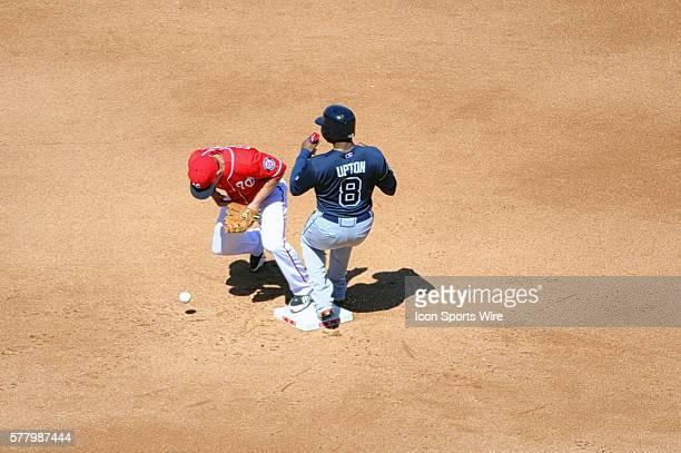 Washington Nationals second baseman Danny Espinosa makes an error as Atlanta Braves left fielder Justin Upton goes into second base at Nationals Park...