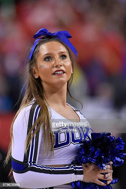 A Duke Blue Devils cheerleader in action during the NCAA Championship Basketball game between the Wisconsin Badgers and the Duke Blue Devils at the...