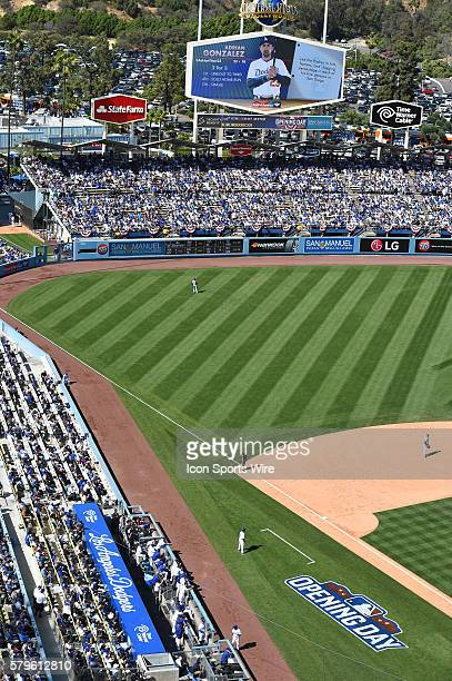 A general view of the Dodger dugout Opening Day logo and the left field bleachers during the Major League Baseball Opening Day game between the San...