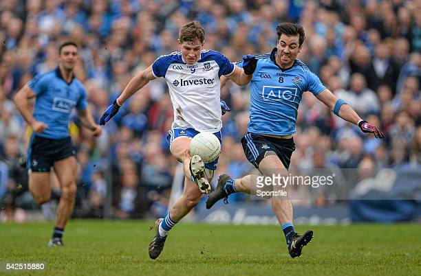 5 April 2015 Darren Hughes Monaghan solos the ball as he attempts to get way from the challenge of Michael Darragh Macauley Dublin Allianz Football...