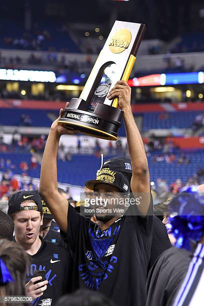 Duke Blue Devils guard Matt Jones celebrates with the NCAA National Championship Trophy in action during the NCAA Championship Basketball game...