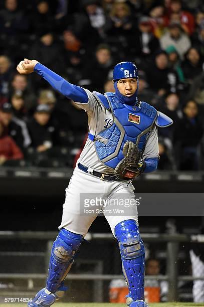 Kansas City Royals catcher Salvador Perez throws to first base cutting down a White Sox base runner during a baseball game between the Kansas City...