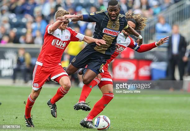 Philadelphia Union midfielder Maurice Edu is caught between New England Revolution midfielder Scott Caldwell and New England Revolution midfielder...