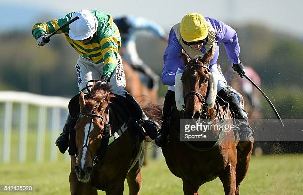 30 April 2015 Uncle Junior right with Patrick Mullins up ahead of Quantitativeeasing with Ms N Carberry up on their way to winning the FBD Cross...